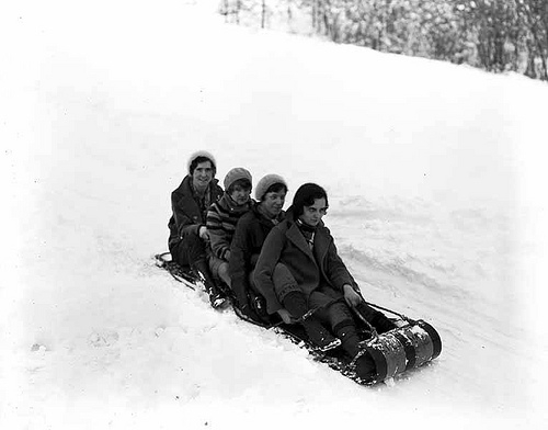 Four women on sled in the snow